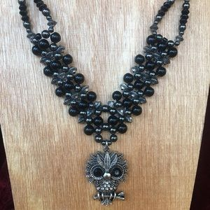 Women's black onyx necklace with owl pendant.